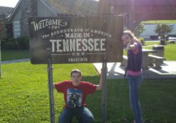 kids next to tennessee sign