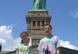 kids in front of statue of liberty
