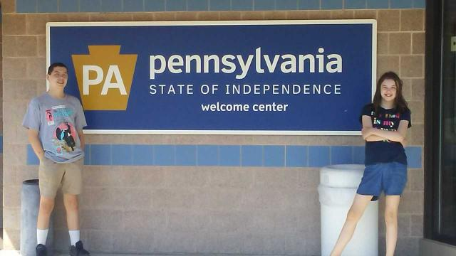 kids in front of Pennsylvania sign